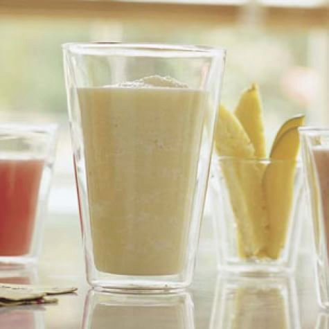 Pineapple Smoothie 1 cup pineapple juice  1 banana, peeled, sliced and frozen  3/4 cup Homemade Yogurt  1 Tbs. sugar  1 1/2 cups ice cubes  1 cup pineapple chunks