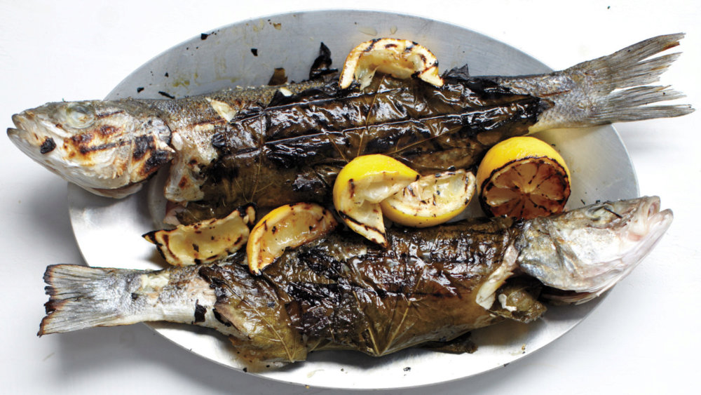 Whole Branzino in Grape Leaves with Zucchini, Olives, and Mint