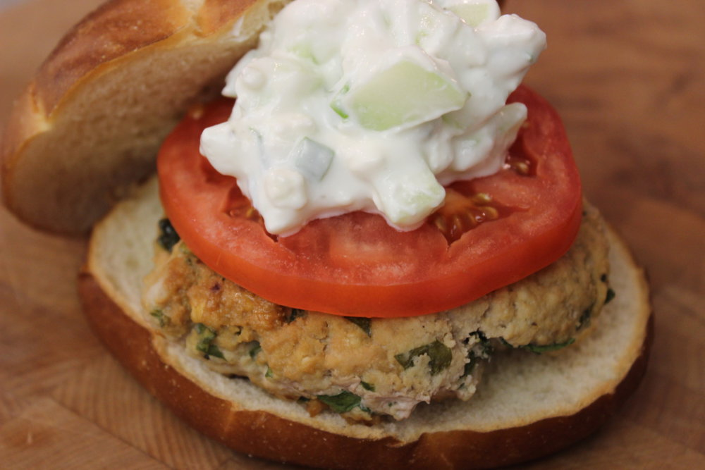 Turkey Burger Recipe with Spinach, Feta, Hummus, and Creamy Cucumber Topping