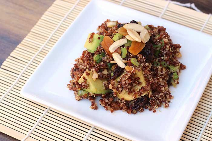 Quinoa and Avocado Salad with Dried Fruit, Toasted Almonds and Lime-Cumin Vinaigrette