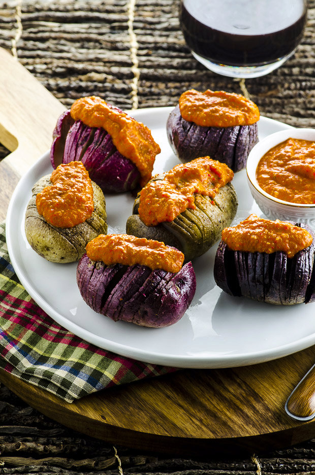 Grilled Tricolor Hasselback Potatoes with Romesco Sauce.