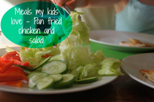 Pan fried chicken and salad