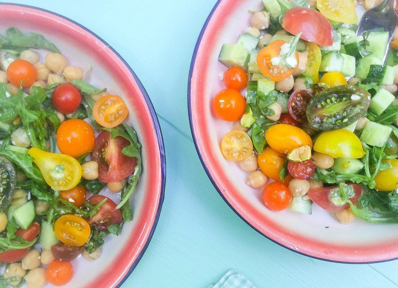 TOMATO-CUCUMBER SALAD WITH CHICKPEAS, ARUGULA AND PISTACHIOS WITH A BASIL-FETA DRESSING