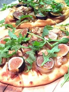 Fig, Caramelized Onions, Goat Cheese, and Arugula Flatbread
