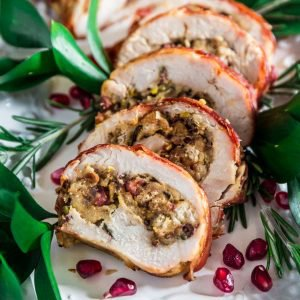 Prosciutto Wrapped Turkey Roulade with Pomegranate-Port Reduction Sauce