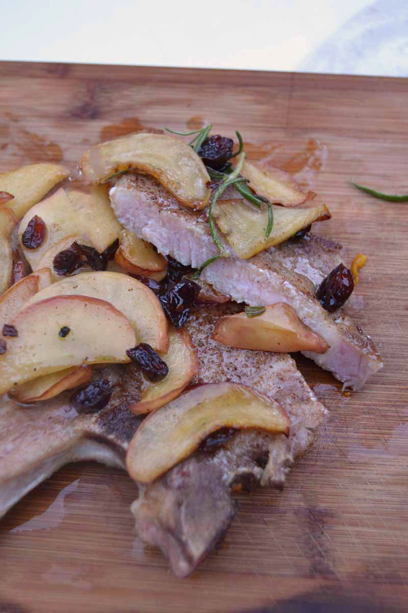 Cinnamon pork chops with sautéed apples and cranberries