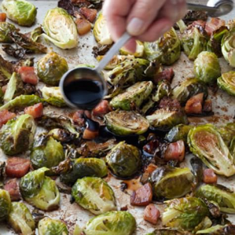 Balsamic-Roasted Brussels Sprouts 1 1/2 lb. brussels sprouts, trimmed and cut in half through the core  4 oz. pancetta, sliced 1/4 inch thick  1/4 cup good olive oil  1 1/2 tsp. kosher salt, plus more, to taste  1/2 tsp. freshly ground pepper, plus more,