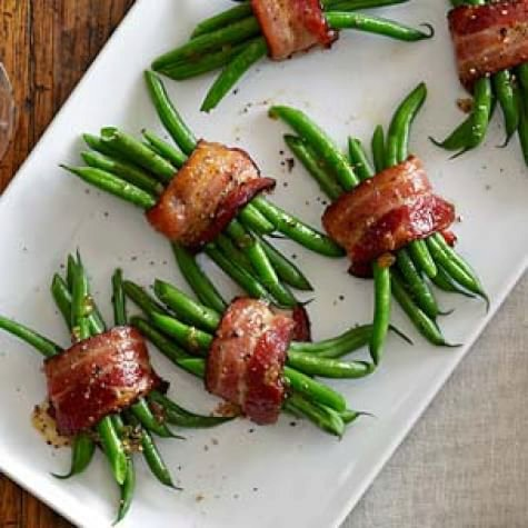 Green Bean Bundles with Bacon and Brown Sugar 8 thick bacon slices  6 Tbs. (3/4 stick) unsalted butter, melted  1 1/2 tsp. kosher salt  3/4 tsp. roasted garlic powder  1 1/2 lb. green beans, trimmed and blanched  1/4 cup firmly packed light brown sugar