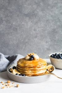 Crème Fraîche Pancakes with Bananas, Blueberries and Toasted Hazelnuts