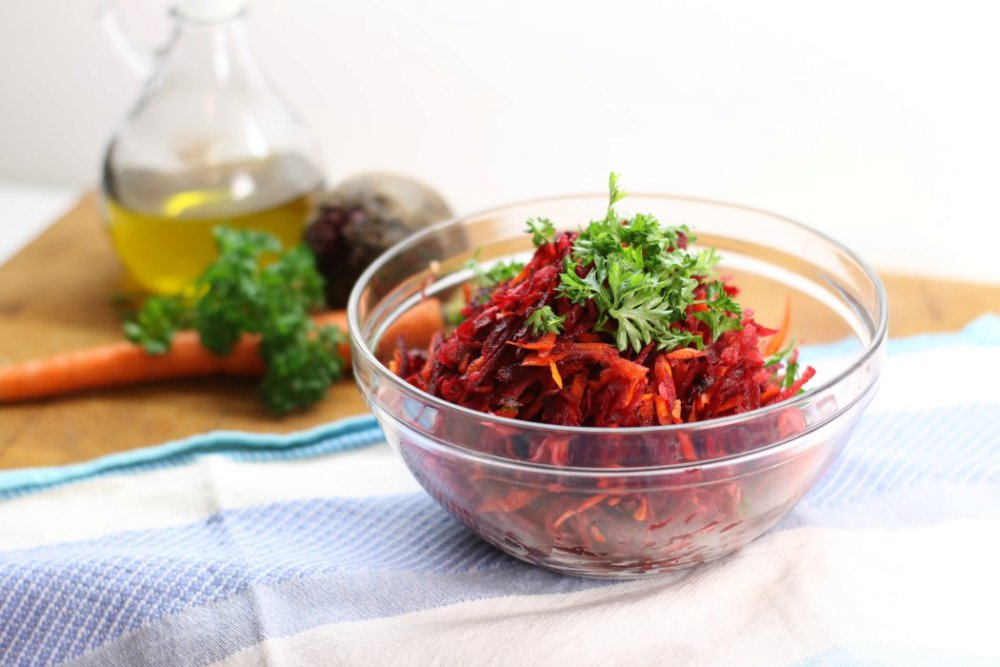 Shredded beet salad with carrot, apple, and walnuts
