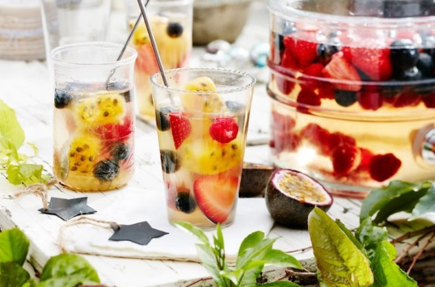Berry sangria with passionfruit ice cubes