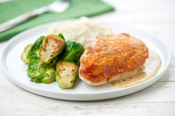 Roasted Skin-On Chicken with cacio e pepe mashed potatoes and Brussels sprouts