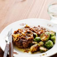 Hamburger patties with onions and Brussels sprouts