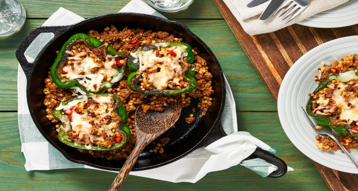 Tuscan Beef-Stuffed Peppers with Pearled Couscous and Melted Mozz